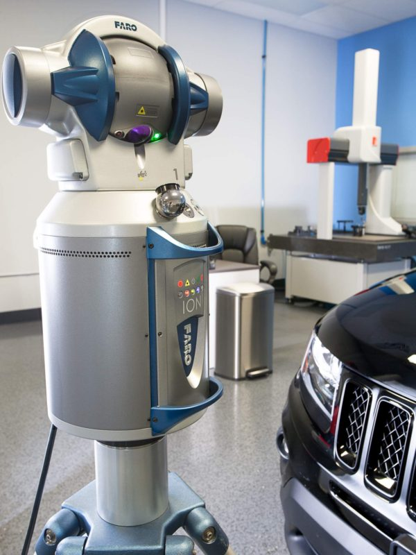 Faro 3D laser tracker inspecting an automobile in the metrology lab