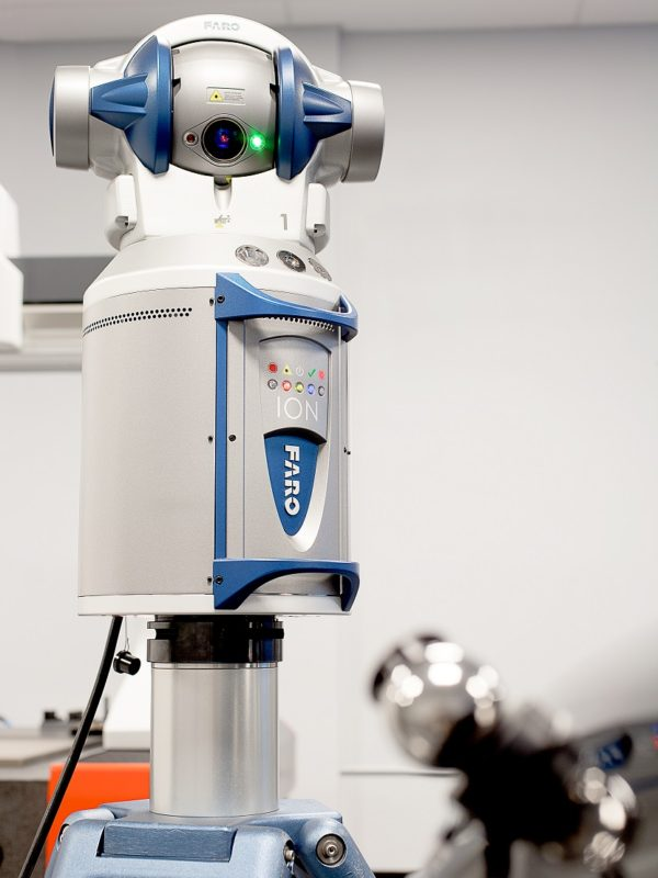 Faro Ion laser tracker set up in the lab to perform dimensional inspection services
