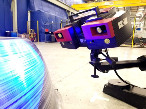 A non-contact structured light 3D scanner doing contract inspection services on-site