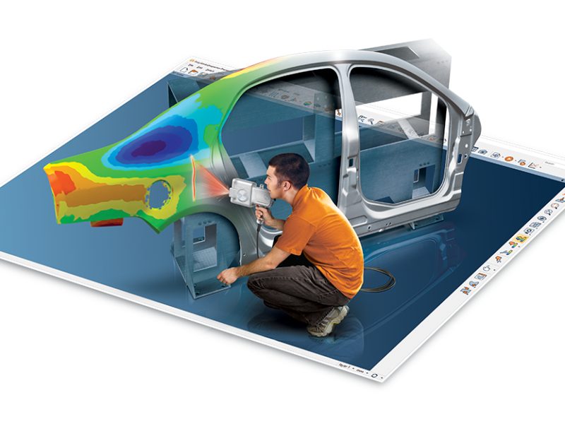 Metrologist using 3D scanner and Polyworks software to create color map of automotive body panels